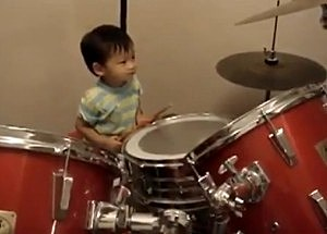 1 year old plays drums