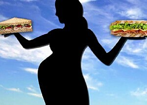 Pregnant woman holds food