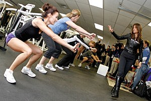 Celebrity trainer Jillian Michaels works with participants during a training session at Auto Club Speedway
