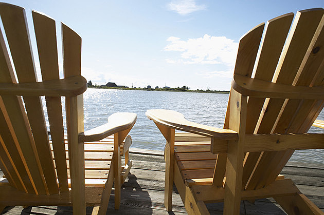 Two Lounge Chairs beside a Lake