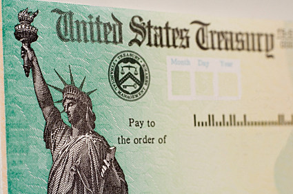 A blank US goverment check with selective focus on the statue of liberty