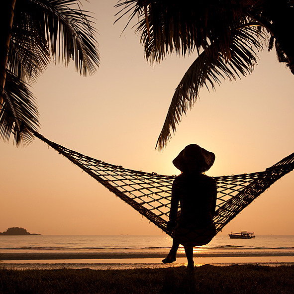 silhouette of woman in hammock